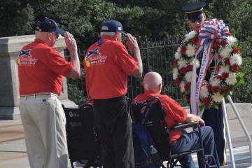 Veterans laying a wreath at the Tomb of the Unknown Soldier
