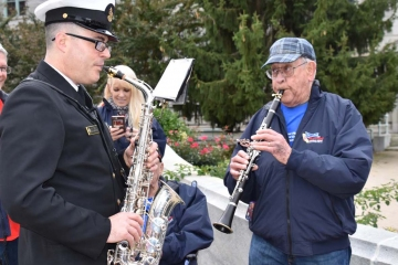 Veteran and Navy band member jamming