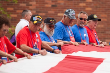 Veterans and Guardians with flag at Fort McHenry