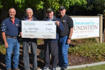 Receiving $5000 donation from the SLO Community Foundation