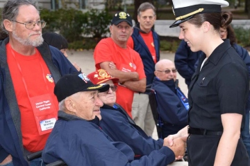 Navy Cadet from Nipomo greeting a veteran