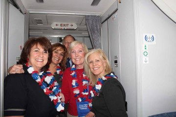 Veteran with flight attendants