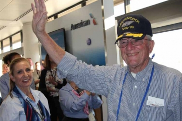 Veteran waving at airport