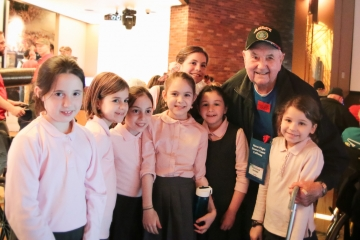 Veterans with students at a school event